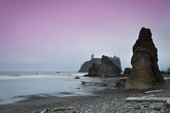 Robijnrood strand bij zonsondergang Royalty-vrije Stock Afbeeldingen