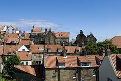 Robin-Hauben-Schacht-Häuser und Dächer Stockbild