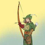 Robin Hood aiming on target. Robin Hood standing with bow. And arrows. Robin Hood in a hat with feather. Young soldier. Noble robber. Defender of weak. Medieval Stock Photos