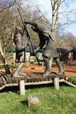 Robin Hood and Little John fighting on the bridge. Sculpture - Robin Hood and Little John fighting on the bridge - at the visitor centre at Edwinstowe in Royalty Free Stock Photography