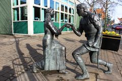 Robin Hood and Maid Marian statue, Edwinstowe. Bronze statue of Robin Hood proposing to Maid Marian by sculptor Neale Andrew (1998) in Edwinstowe on the edge of Royalty Free Stock Photography