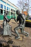 Robin Hood and Maid Marian statue, Edwinstowe. Bronze statue of Robin Hood proposing to Maid Marian by sculptor Neale Andrew (1998) is in Edwinstowe on the edge Stock Image