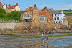 Robin Hood's Bay East Yorkshire. Sand and rock pools at Robin Hood's Bay  East Yorkshire, a famous haunt of artists and fossil hunters and a holiday destination Royalty Free Stock Image