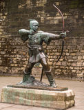 Robin Hood of Nottingham. Statue of the legendary outlaw Robin Hood standing on  a plinth outside the castle wall in Nottingham, England Royalty Free Stock Photo