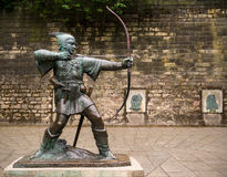 Robin Hood of Nottingham. Statue of the legendary outlaw Robin Hood standing on a plinth outside the castle wall in Nottingham, England Stock Photo