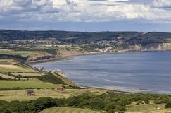 Robin Hoods Bay. View of Robin Hoods Bay from the fields at Ravenscar stock images
