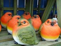 Robin red breast - ceramic garden ornaments. Colourful ceramic garden ornaments on wooden shelf Stock Photos