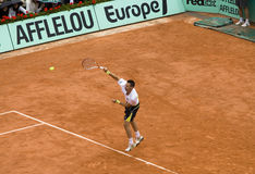 Robin Soderling of Sweden in action at French Op. PARIS - JUNE 7: Robin Soderling of Sweden in action at French Open, Roland Garros, final game on June 7, 2009 stock image
