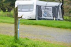Robinet d'eau sur un terrain de camping au R-U photos stock