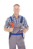 Robinet de Holding Wrench And de plombier photo stock