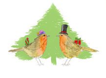 Robins and Christmas tree. Royalty Free Stock Images