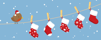 Robins Stockings. Little robin on a clothesline with stockings hanging out to dry Stock Photography