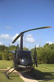 The Robinson R44 Helicopter from Cana Fly in Punta Cana, Dominican Republic. PUNTA CANA, DOMINICAN REPUBLIC - DECEMBER 31 The Robinson R44 Helicopter from Cana Royalty Free Stock Images