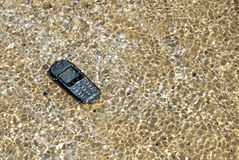 Robinsons Rescue 12. Mobile phone was washed ashore stock photos
