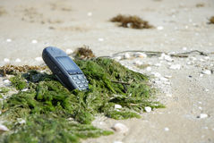 Robinsons Rescue 6. Mobile phone was washed ashore stock images