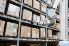 Roboric arm in warehouse royalty free stock photo