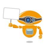Robot arancio che giudica un cartello in bianco isolato su fondo bianco Immagine Stock Libera da Diritti