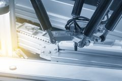 The robot arm catch for electronic assembly line. The robot for hi-technology manufacturing process royalty free stock photo