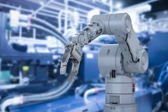Robot arm in factory Royalty Free Stock Image