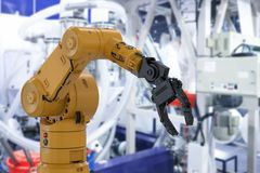 Robot arm in factory. 3d rendering robot arm or robotic hand in factory stock image