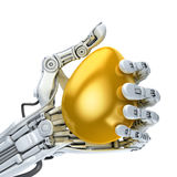 Robot arm holding a golden Easter egg. Stock Images