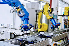 Robot  arm. Intelligent  robot  arm used in modern factory ,automated assembly line Royalty Free Stock Image