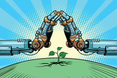 The robot arm protect green sprout, technology environment and n Stock Photo