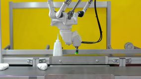 Robot arm sorting and lifitng products on conveyor belt stock video