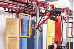 Robot arm spray painting window frame Stock Images