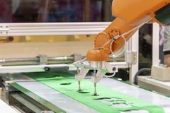 The robot arm for transfer the rubber sheet. In manufacturing process.The industrial 4.0 concept stock photos