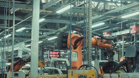 Robotics work in production line of car stock video footage