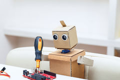Robot  with arms solder red chip on the table Stock Photo