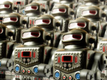 Robot army 3. Sinister marching army of toy robots Royalty Free Stock Image