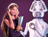 Robot teacher for kid. White plastic ai robotic device. Robot artificial intelligence teacher for kid. White plastic ai robotic device read for children royalty free stock photo
