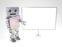 Robot at balckboard. Old style robot at blank white board Royalty Free Stock Photography