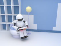 Robot with book Stock Photo