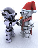 Robot building a snowman Royalty Free Stock Photography