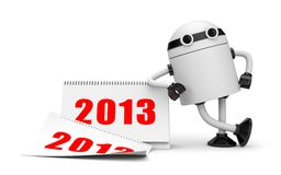 Robot with calendar 2013 Royalty Free Stock Photography