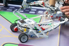 Robot Car, robotics with remote control. Fan robots with childre. N's hands in the background. School Robotics learning for children. Modern training. Model kits stock images