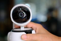 Robot cctv infrared wifi camera in hand for security home. Stock Photos