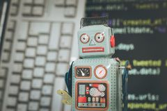Symbol for a chatbot or social bot and algorithms, program code in the background. Robot chatbot social algorithm artificial code intelligence ai data big stock photo