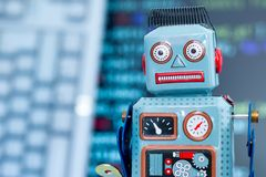 Symbol for a chatbot or social bot and algorithms, program code in the background. Robot chatbot social algorithm artificial code intelligence ai data big stock photos