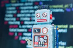 Symbol for a chatbot or social bot and algorithms, program code in the background. Robot chatbot social algorithm artificial code intelligence ai data big royalty free stock photography