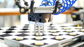 Robot checkers technologies. Robot play checkers close-up. Modern technologies nand