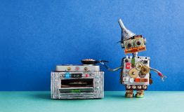 Robot chef cooking. frying pan electronic stove oven. Creative design toys, automation robotic future smart home concept Royalty Free Stock Photos