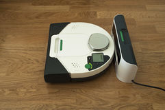 Robot cleaner in charge. Robotic Wireless Vacuum Cleaner in charge Royalty Free Stock Image