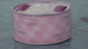 Robot combat battle bot in shape of pink cake spinning on arena. Robot combat battle bot in shape of pink cake spinning twisting metal chains on arena scratched stock footage