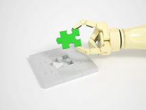 Robot completes jigsaw puzzle game Royalty Free Stock Photos