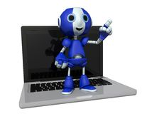 Robot and Computer Royalty Free Stock Photography