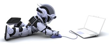 Robot with a computer and mouse Stock Photo